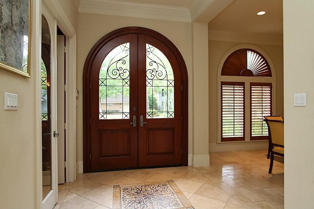 Traditional Entryway with Arched window, French doors, High ceiling, complex marble floors, Glass panel door, Crown molding