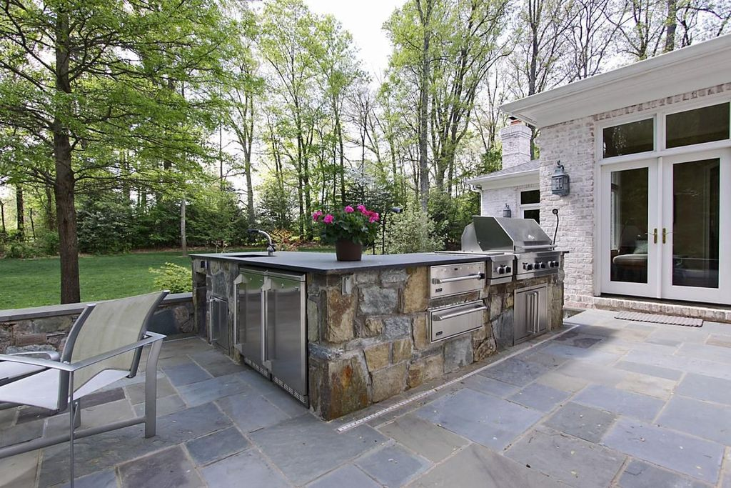 Traditional Patio with warming oven, electric cooktop, Custom hood, Undermount sink, Concrete counters, double wall oven