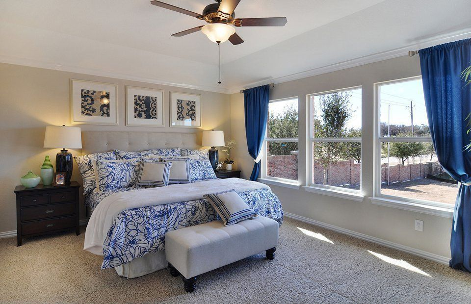 Modern Guest Bedroom with double-hung window, Standard height, Ceiling fan, Carpet, flush light, Crown molding
