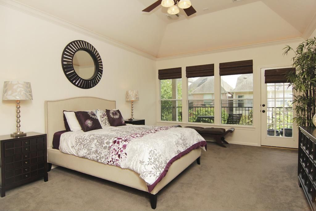 Traditional Guest Bedroom with double-hung window, Crown molding, High ceiling, flush light, Carpet, French doors