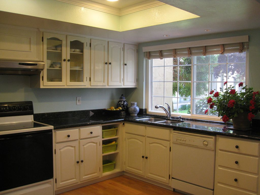 Traditional Kitchen with Simple granite counters, Simple Granite, L-shaped, Raised panel, Inset cabinets