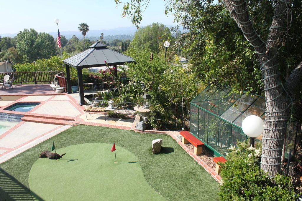 Traditional Landscape/Yard with Pathway, Fence, exterior brick floors, Raised beds, Gazebo