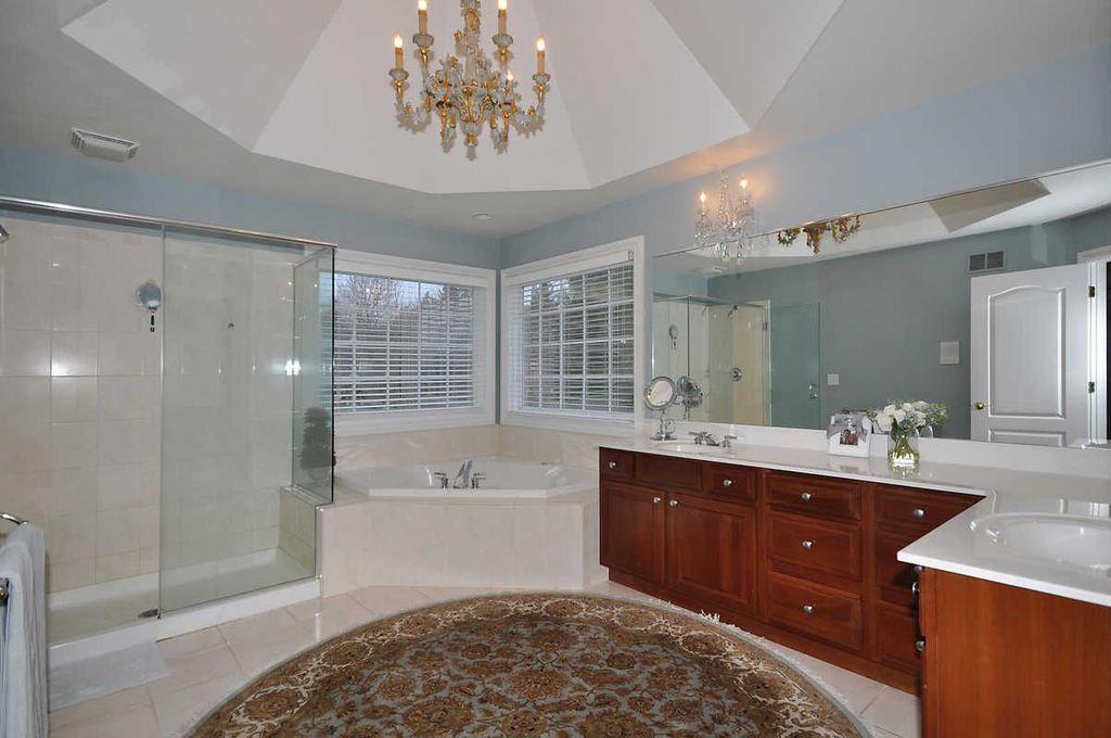 Traditional Master Bathroom with Casement, partial backsplash, Bathtub, Shower, Simple marble counters, drop in bathtub