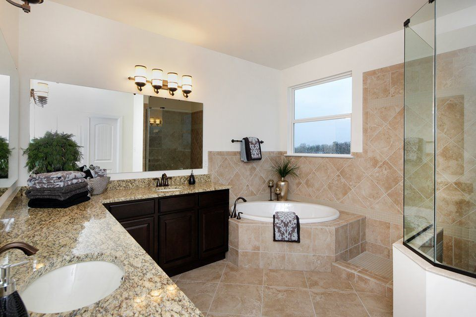 Mediterranean Full Bathroom with stone tile floors, Simple Granite, Undermount sink, wall-mounted above mirror bathroom light