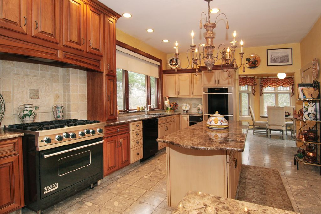 Traditional Kitchen with can lights, Raised panel, Framed Partial Panel, Stone Tile, Standard height, Transom window