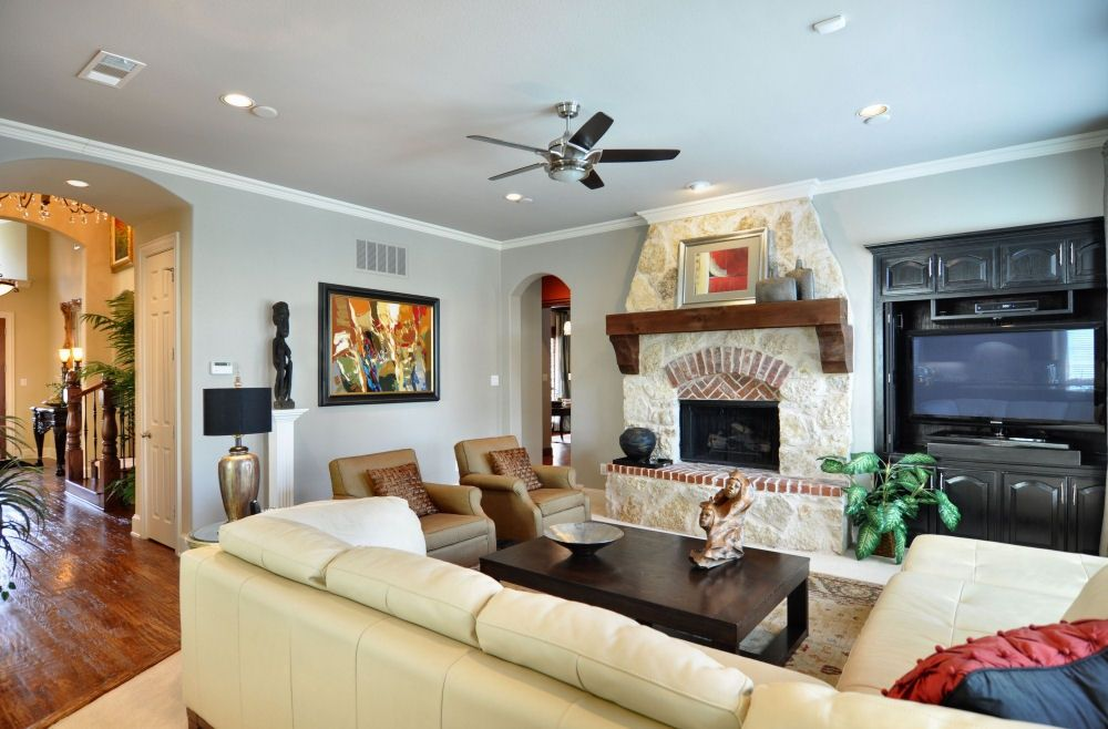 Eclectic Living Room with can lights, Standard height, Crown molding, Ceiling fan, Hardwood floors