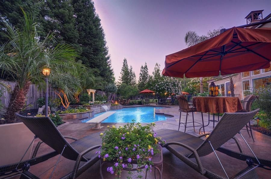 Modern Swimming Pool with Other Pool Type, Fence, exterior concrete tile floors, Raised beds, specialty window