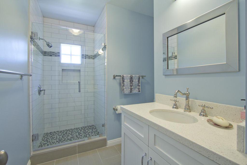 Contemporary 3/4 Bathroom with tile shower, slate tile floors, Shower head, Standard height, Adjustable showerhead, Shower