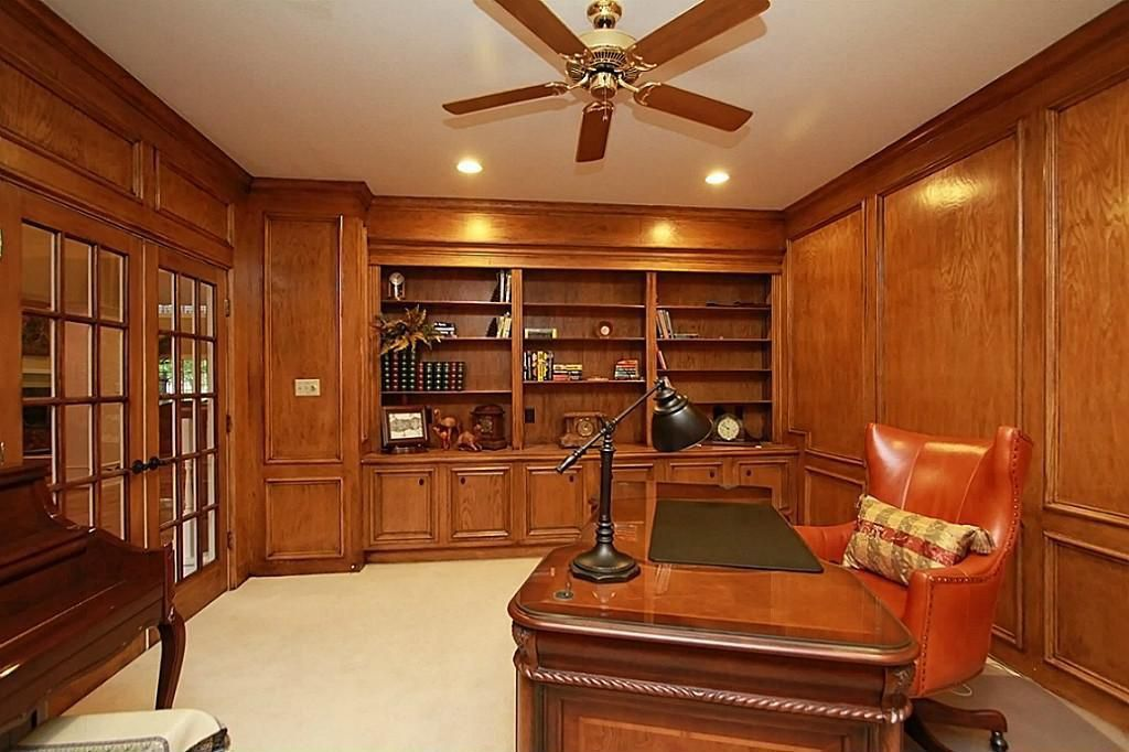Traditional Home Office with Crown molding, Carpet, can lights, Built-in bookshelf, Standard height, French doors