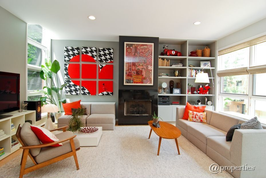 Eclectic Living Room with metal fireplace, can lights, Built-in bookshelf, Fireplace, Laminate floors, double-hung window