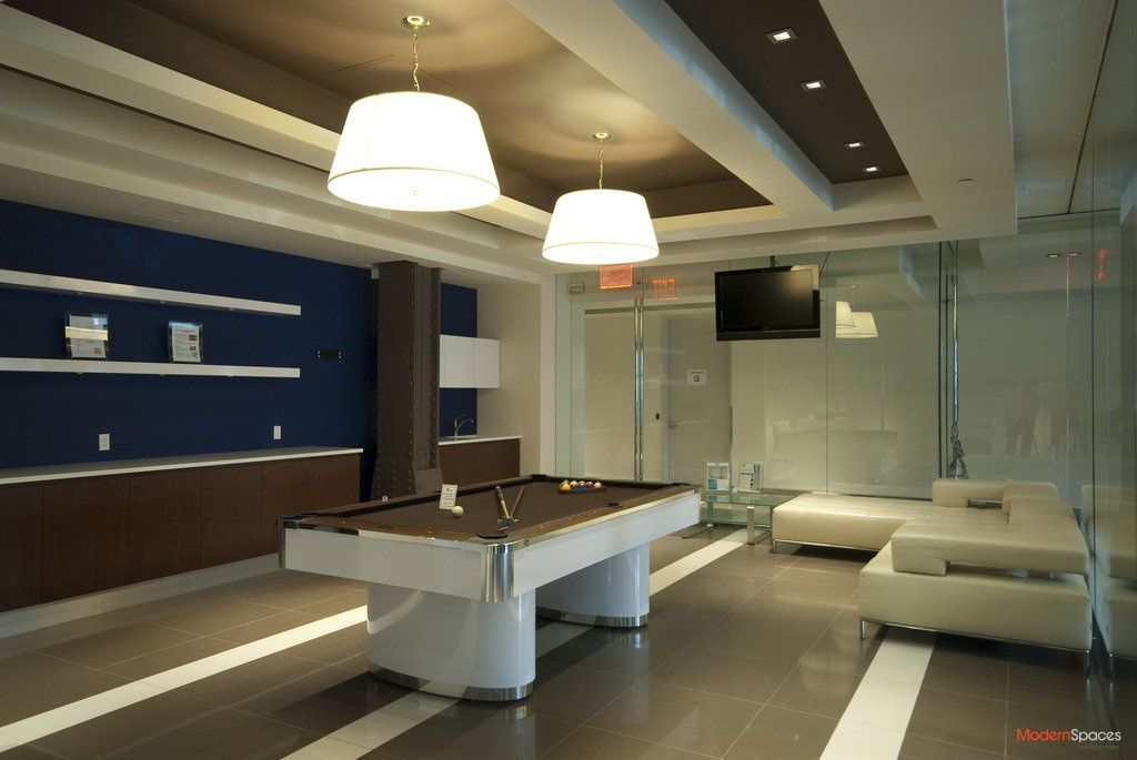 Contemporary game room with box ceiling built in bookshelf zillow digs - Spectacular modern pendant lighting fixtures as center of attention ...