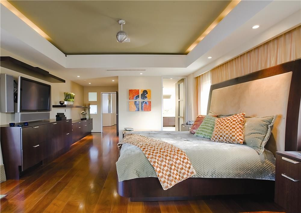 Contemporary Master Bedroom with Glass panel door, Box ceiling, can lights, Hardwood floors, Standard height
