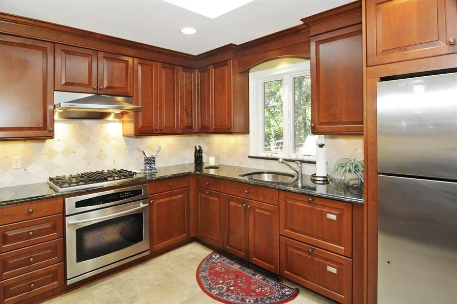 Traditional Kitchen with Built In Refrigerator, Undermount sink, Exposed beam, full backsplash, Standard height, can lights