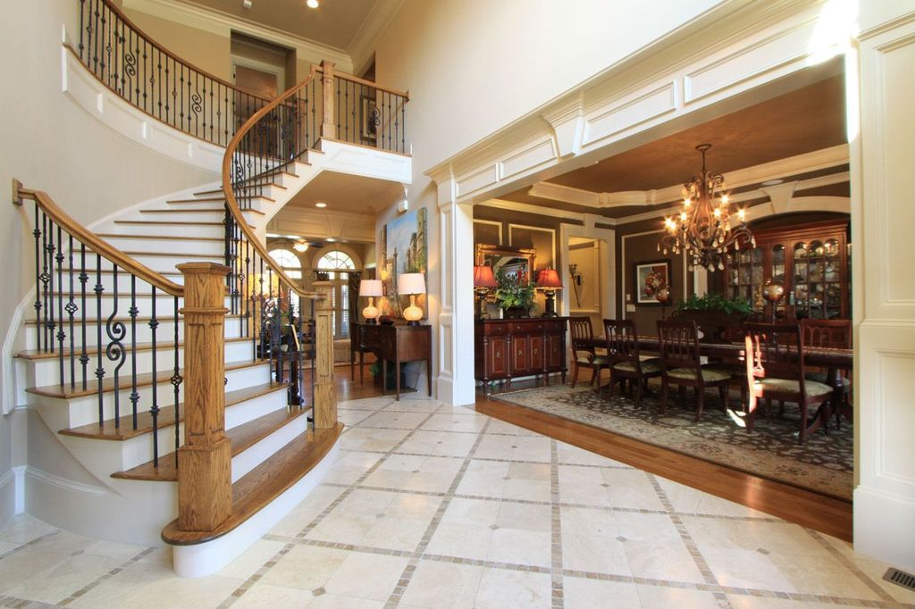 Traditional Entryway with Crown molding, stone tile floors, High ceiling, Balcony, simple marble tile floors