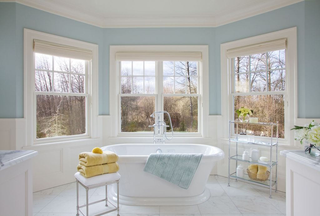 Traditional Master Bathroom with Complex marble counters, Carrara marble, Standard height, Bathtub, Freestanding, Casement