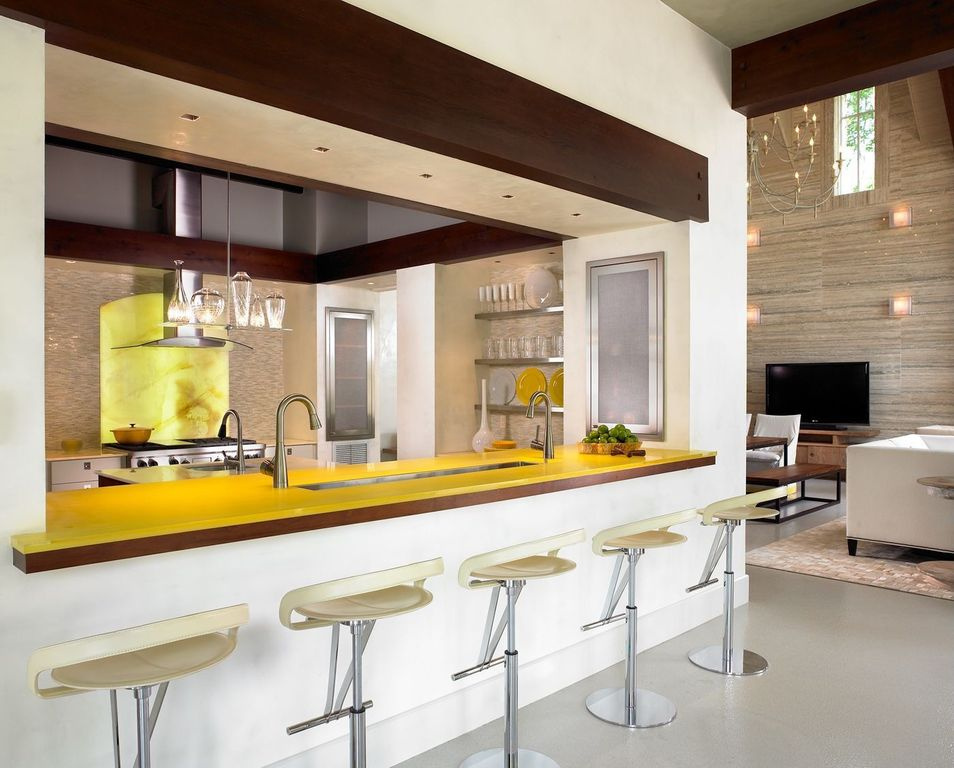 Contemporary Kitchen with can lights, Pendant light, Exposed beam, Sandstone Tile, Kitchen island, High ceiling, Glass panel