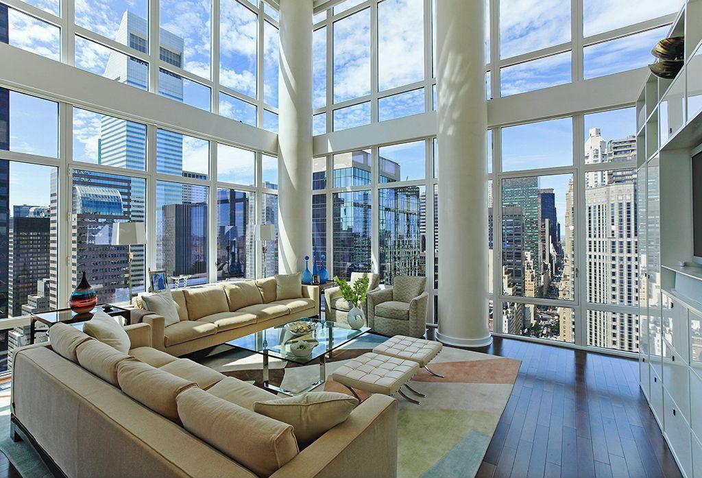 Modern Living Room with West elm henry sofa - grand, Steel frame windows, Barcelona table, Paint, Area rug, Barcelona stool