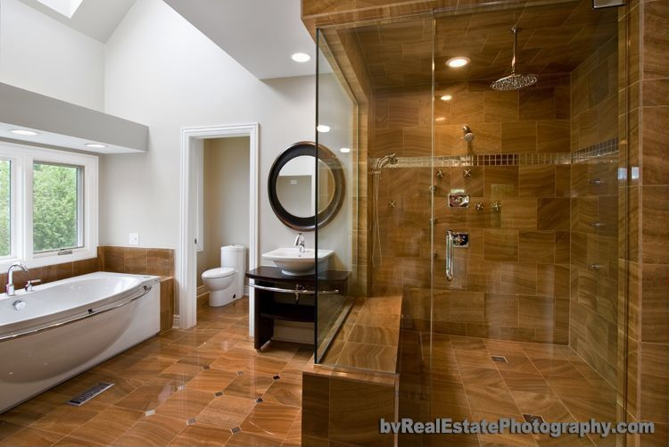 Modern Master Bathroom with Rain shower, Handheld showerhead, large ceramic tile floors, Wood counters, Skylight, can lights