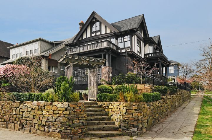 Traditional Landscape/Yard with Fence, Raised beds, Deck Railing, Casement, double-hung window, exterior stone floors, Arbor