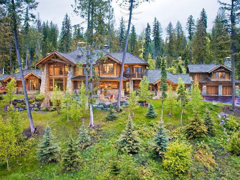 Rustic Exterior of Home with Natural wood exterior, picture window