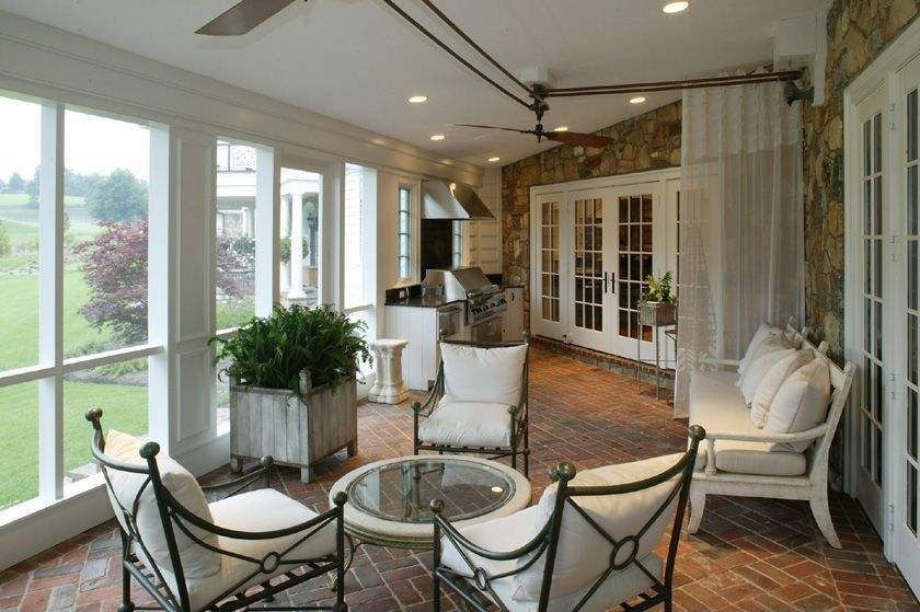 Contemporary Porch with picture window, exterior brick floors, Outdoor kitchen, Screened porch, French doors