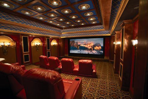 Traditional Home Theater with Wall sconce, Carpet, can lights, interior wallpaper, High ceiling, Box ceiling, Crown molding