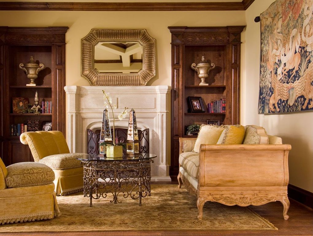Traditional Living Room with Built-in bookshelf, Laminate floors, Fireplace, Crown molding, Cement fireplace, Standard height