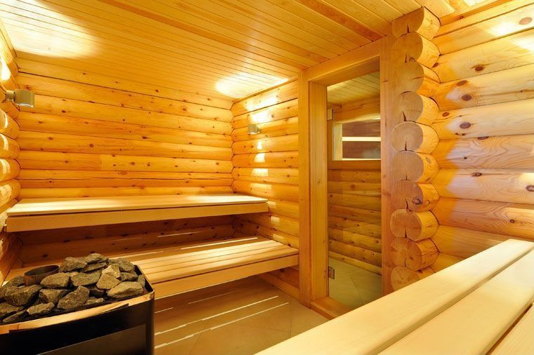 Rustic Master Bathroom with Sauna, Exposed logs, Daltile ever colorbody porcelain light textured ev02, Frameless glass door