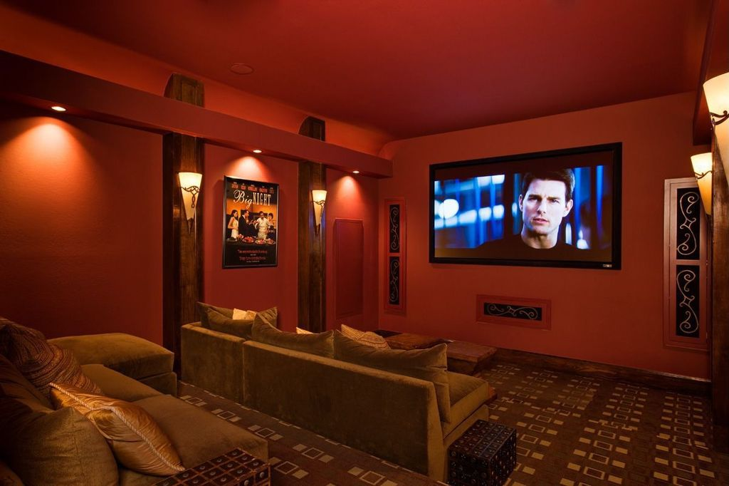 Art Deco Home Theater with Carpet, Wall sconce, Standard height, can lights, Paint