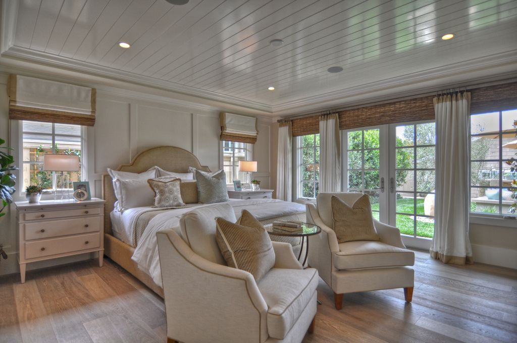 Traditional Master Bedroom with French doors, Engineered hardwood flooring, can lights, Crown molding, Laminate floors
