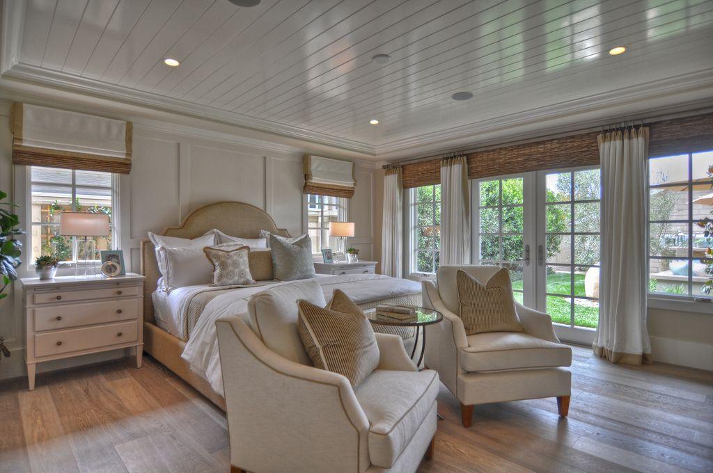 Traditional Master Bedroom with Crown molding, Engineered hardwood flooring, Laminate floors, can lights, Standard height