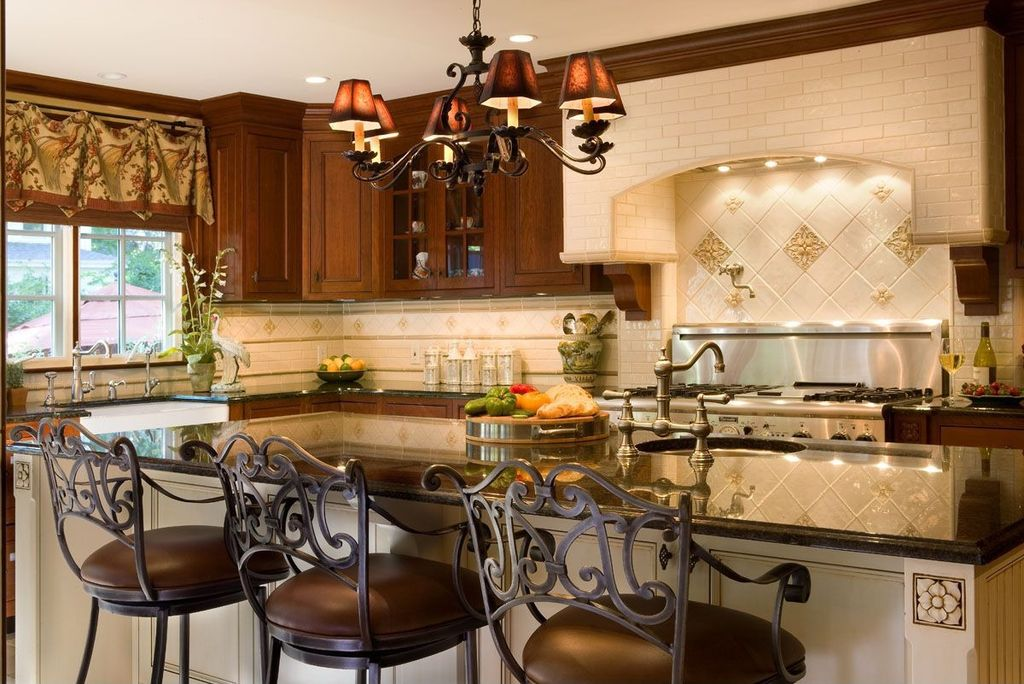 Traditional Kitchen with Farmhouse sink, Breakfast bar, Simple granite counters, Custom hood, Kitchen island, Glass panel