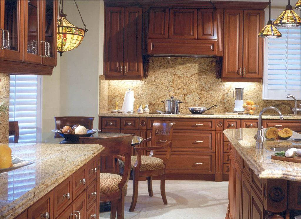 Traditional Kitchen with Kitchen island, can lights, L-shaped, Simple granite counters, Undermount sink, Framed Partial Panel