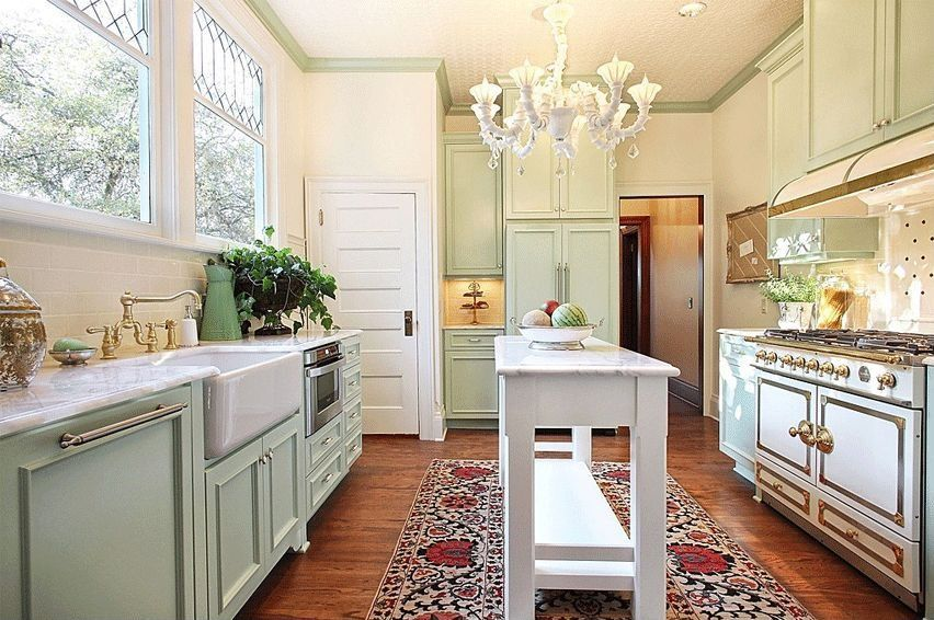 Traditional Kitchen with U-shaped, Subway Tile, Complex marble counters, Chandelier, Flat panel cabinets, Custom hood