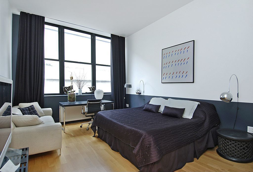 Contemporary Master Bedroom with Laminate floors, bedroom reading light, Standard height, double-hung window