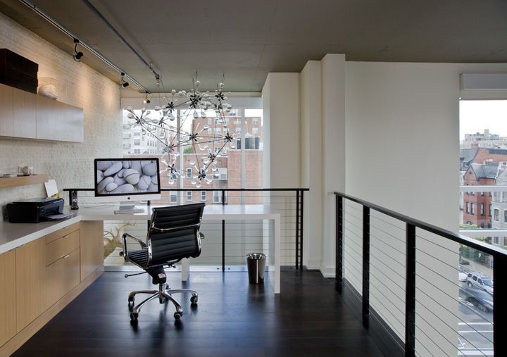 Contemporary Home Office with Design within reach - eames aluminum management chair, Chandelier, High ceiling, Paint