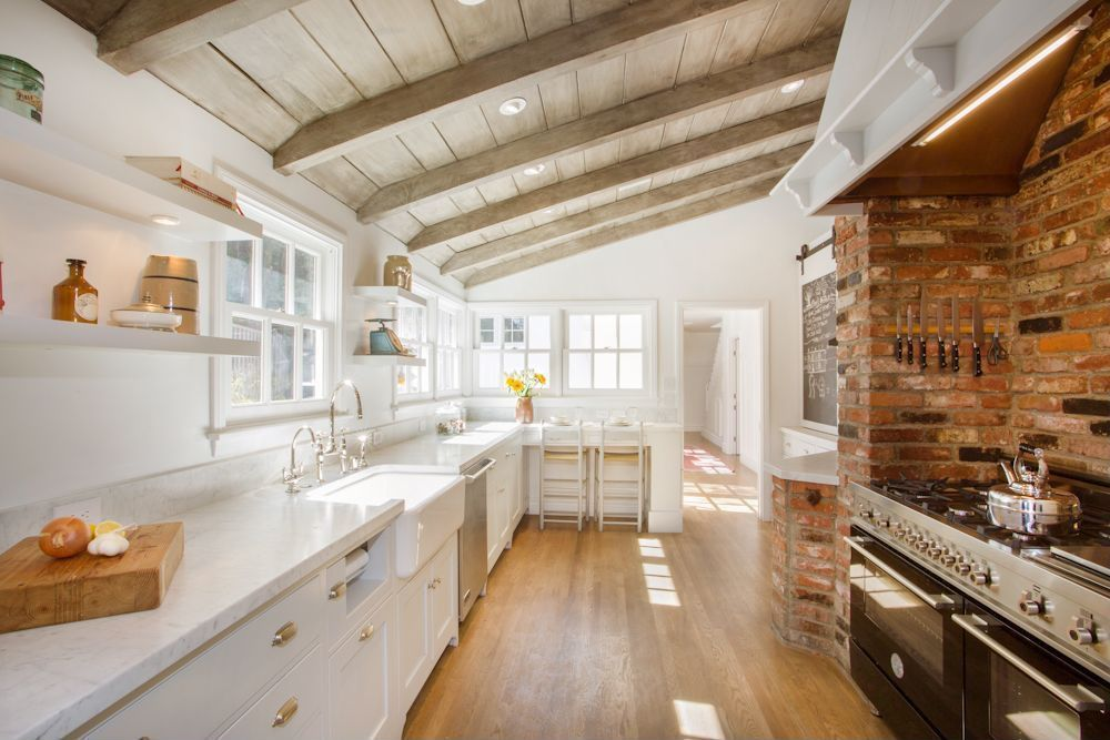 Country Kitchen with Belle foret apron front kitchen sink, U-shaped, Flat panel cabinets, White slim line floating shelf