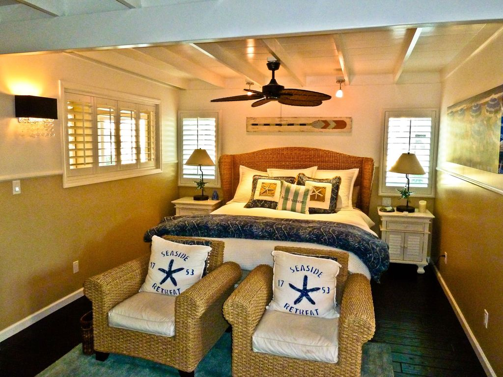 Tropical Guest Bedroom with Wildon Home Paradise Club Chair, Outer Banks Nightstand, Pottery Barn Seagrass Headboard
