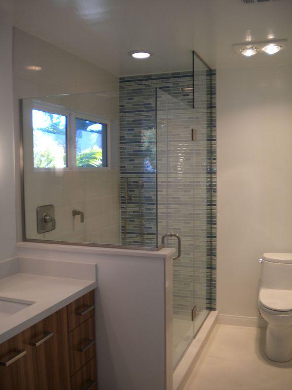 Contemporary 3/4 Bathroom with Casement, three quarter bath, Dupont corian designer white, Undermount sink, Carpet, Flush