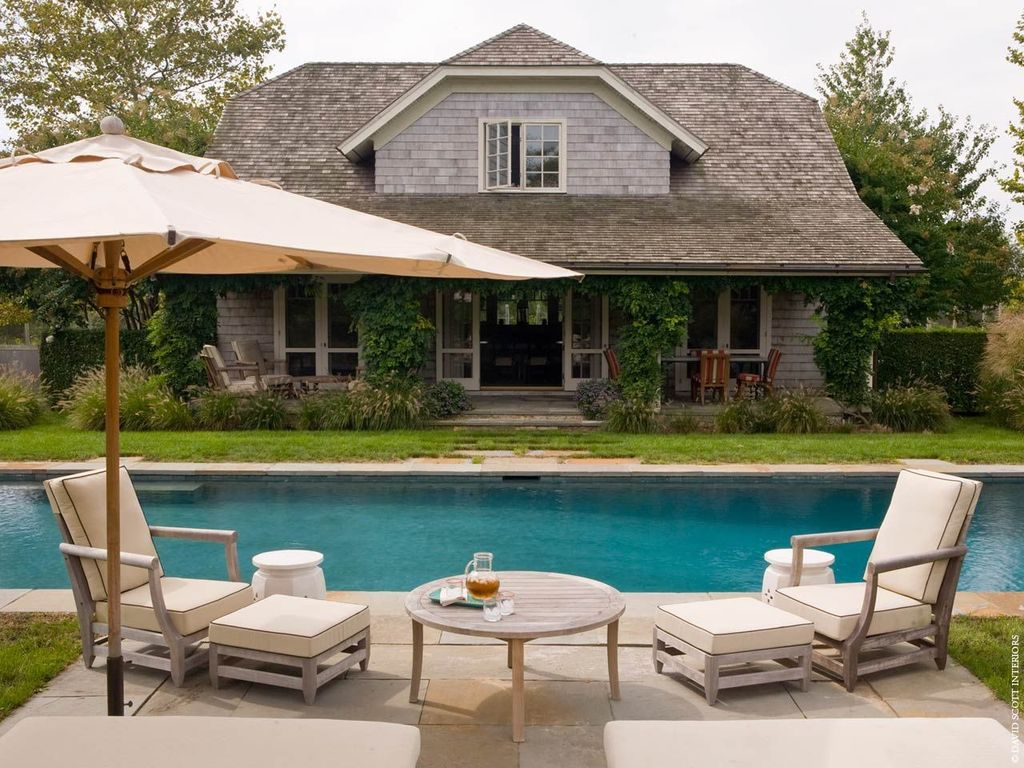 Cottage Swimming Pool with Casement, Fence, exterior tile floors, French doors, Pathway, exterior concrete tile floors