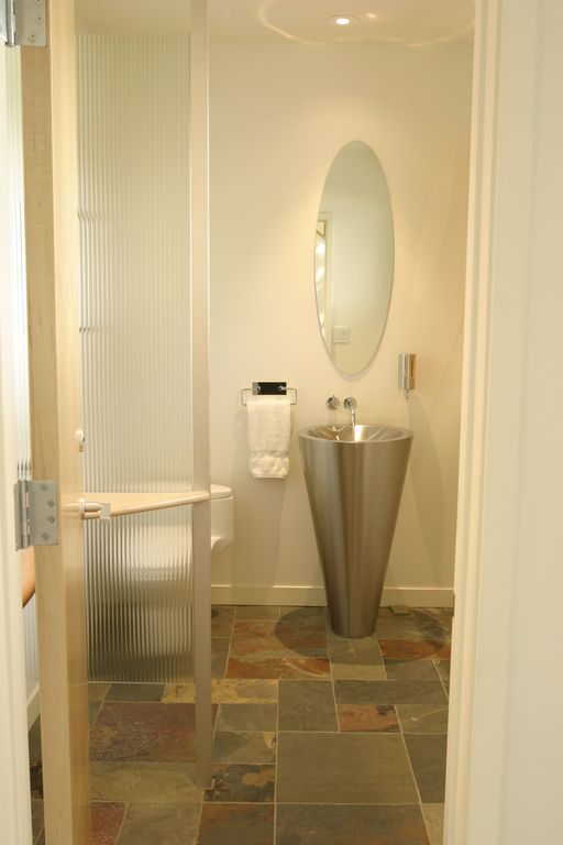 Contemporary Powder Room with Standard height, Powder room, Pedestal sink, Ren-wil mirror oval beveled mirror, can lights