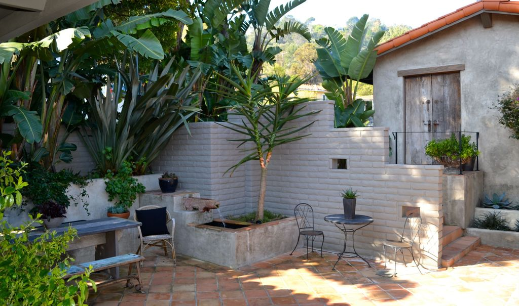 Mediterranean Patio with Cement wall, exterior tile floors, Spanish tile roof, Fence, Raised beds, Pathway, six panel door