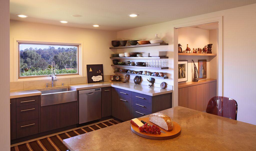 Contemporary Kitchen with Kitchen island, Farmhouse sink, Limestone Tile, European Cabinets, Breakfast bar, Corian counters