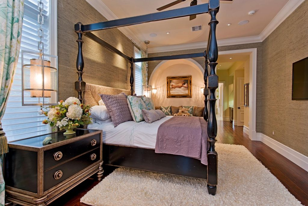 Contemporary Master Bedroom with can lights, Laminate floors, Crown molding, Casement, interior wallpaper, Wall sconce