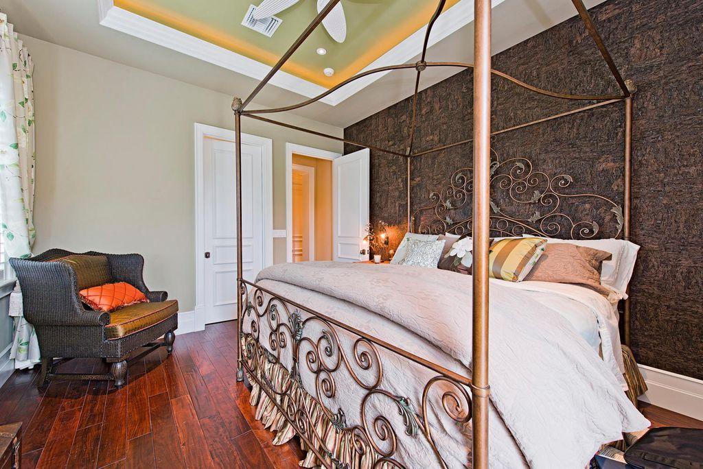 Traditional Guest Bedroom with can lights, Standard height, Hardwood floors, specialty window, Ceiling fan, six panel door