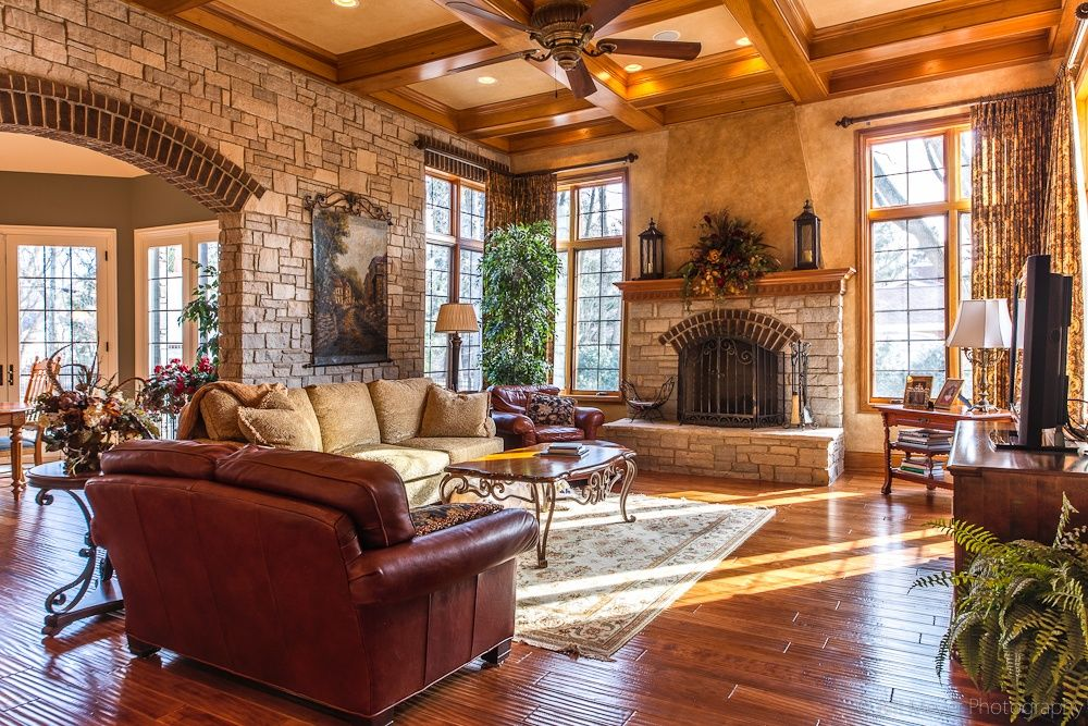 Traditional Family Room with Abbyson Living Harbor Premium Leather Loveseat, Casement, High ceiling, Ceiling fan, Fireplace