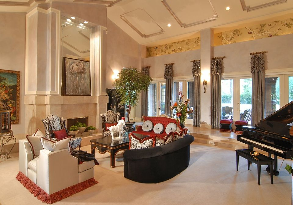 Traditional Living Room with Fireplace, French doors, Cathedral ceiling, Wall sconce, Cement fireplace, can lights, Carpet