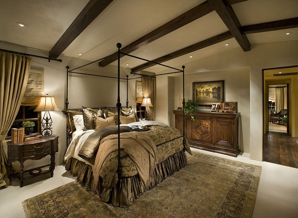 Mediterranean Master Bedroom with Sylvania canopy bed, Dynamic rugs legacy, Exposed beams, Dark hardwood floors, Paint