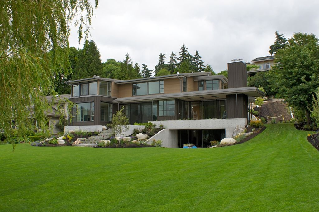 Contemporary Exterior of Home with Raised beds, Private backyard, Pathway, Covered patio, Paint 2, picture window, Grass