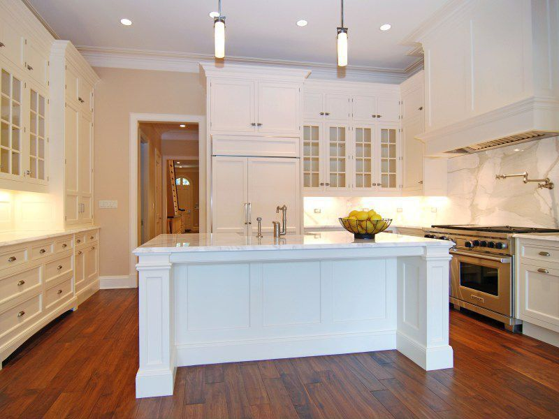 Traditional Kitchen with Complex Marble, Glass panel, Custom hood, can lights, Built In Panel Ready Refrigerator, Flush